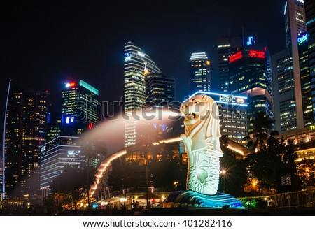 Singapore - 21 September 2015: Beautiful Singapore city skyline and the famous Merlion statue at night.