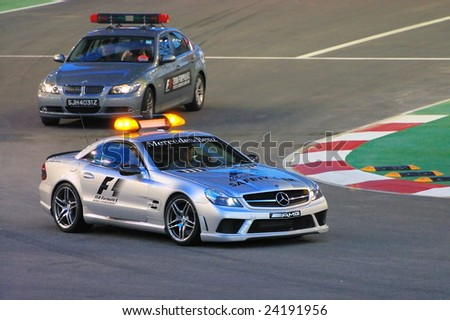 SINGAPORE - SEPTEMBER 26: Safety cars for first Formula One night race September 26, 2008 in Singapore - stock photo