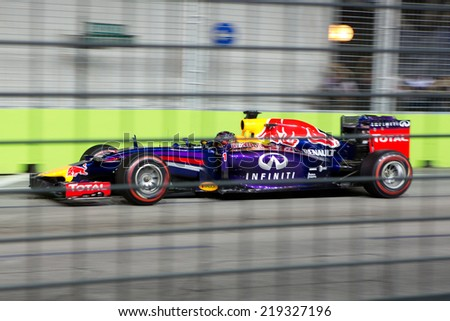 SINGAPORE - SEPTEMBER 20:  Sebastian Vettel of the Infiniti Red Bull Renault clinching the fourth position in the qualifying round of the Singapore Grand Prix on SEPT 20, 2014 - stock photo