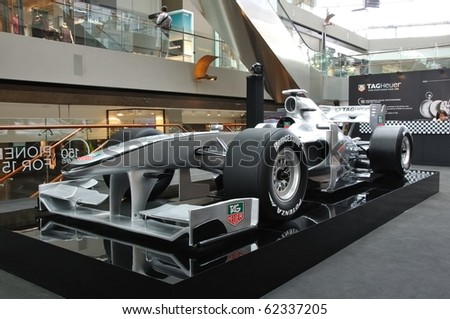 SINGAPORE - SEPTEMBER 27: Tag Heuer Formula 1 sport car on display at The Shoppes at Marina Bay Sands on September 27, 2010 in Singapore - stock photo