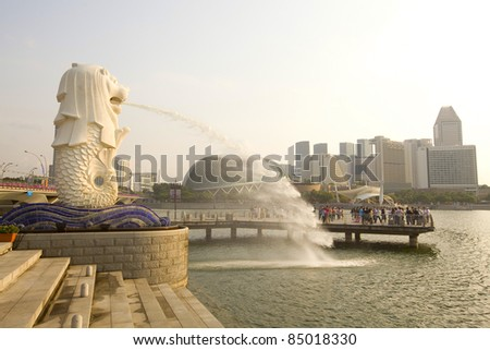 SINGAPORE-SEPTEMBER 5: The Merlion fountain spouts water in front of Esplanade Theater on Sept 5, 2011. It's an imaginary creature with head of lion& body of fish, often seen as a symbol of Singapore. - stock photo