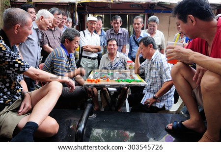 Singapore, September 2012. Unidentified local people played chinese chess in Chinatown street market. - stock photo