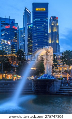 Singapore, Singapore - January 20, 2014: Singapore Merlion after sunset with the city skyline in the background - stock photo
