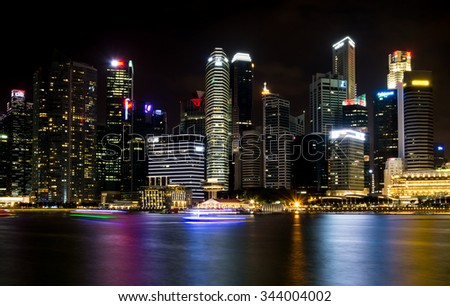 SINGAPORE, SINGAPORE - JULY 19 2015: View of downtown Singapore city at night. Singapore is one of the world's major commercial hubs