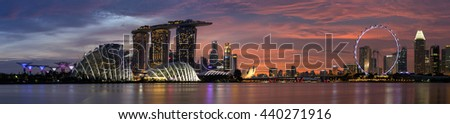 Singapore, Singapore - May 22, 2016: Marina Bay Sands Hotel, Gardens by the Bay and Singapore city skyline panorama during the sunset in Singapore. - stock photo