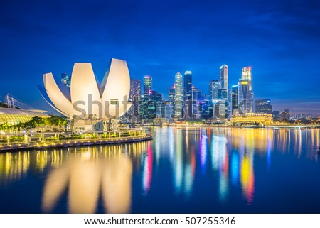 Singapore, Singapore - October 23, 2016: Singapore city skyline and view of Marina Bay at night in Singapore city.