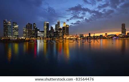 Singapore skyline and river at sunset - stock photo