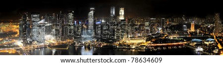 Singapore Skyline at Night from Marina Bay Sands resort - stock photo