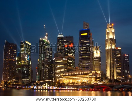 Singapore skyline at night, seen from the Esplanade - stock photo