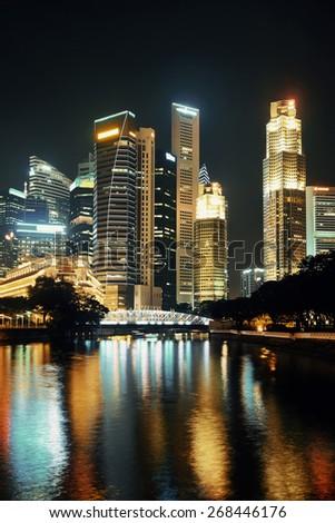 Singapore skyline at night with urban buildings - stock photo