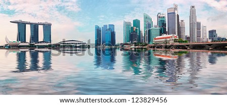 Singapore skyline - modern skyscrapers with reflection in water - stock photo