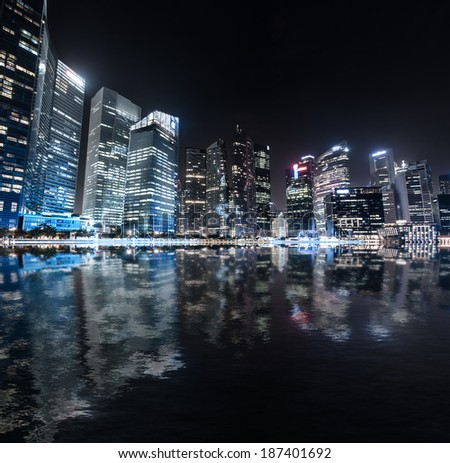 Singapore skyline night panorama. Modern urban city view of business district in downtown near Marina Bay Sands. Waterfront landscape of famous tourist travel destination. Evening panorama  - stock photo