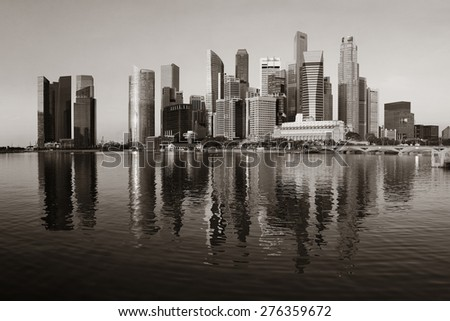 Singapore skyline with urban buildings over water - stock photo