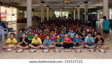 SINGBURI THAILAND- SEP 19: unidentified Thai Orphans receive food donations from philanthropists on September 19, 2015 at Sriudom Witdaya school Singburi Thailand - stock photo