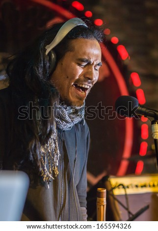 Singer and musician on the stage lights - stock photo
