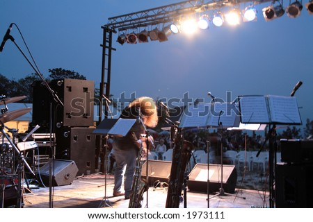 singer is on stage among instruments - stock photo