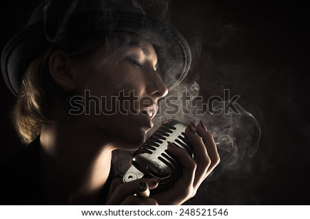 singer woman with retro microphone - stock photo