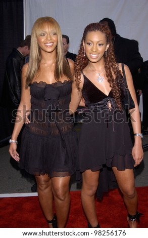 Singers BEYONCE (left) & SOLANGE KNOWLES at the 30th Annual American Music Awards in Los Angeles. 13JAN2003.   Paul Smith / Featureflash - stock photo
