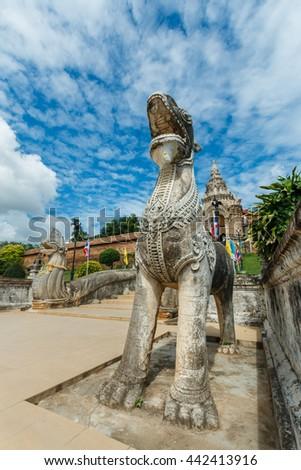Singha and naga statue at Wat Prathat Lampang Luang Temple, Lampang, Thailand - stock photo