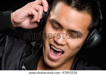 Singing Asian Man - stock photo