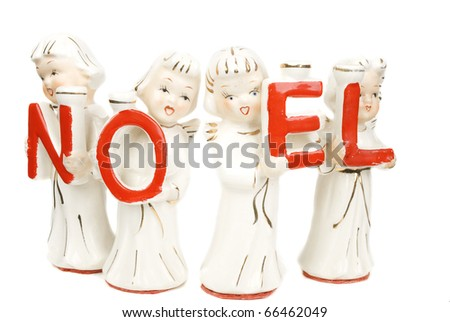Singing four angels with Noel sigh candleholders isolated on the white background. - stock photo