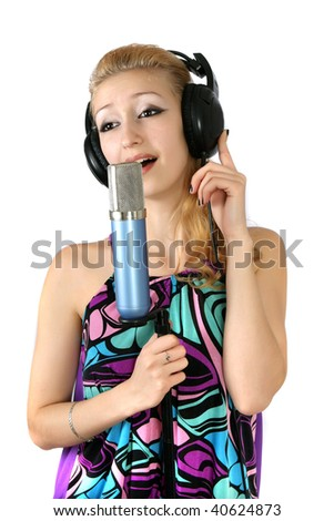 singing girl in headphones singing into a microphone - stock photo