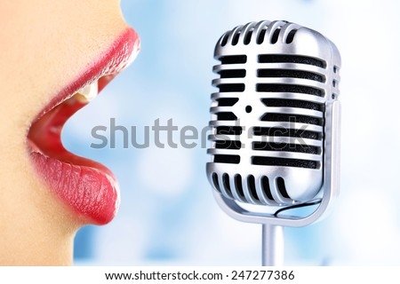 Singing woman and retro microphone, karaoke concept - stock photo