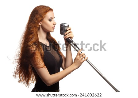 Singing Woman with Retro Microphone.  - stock photo