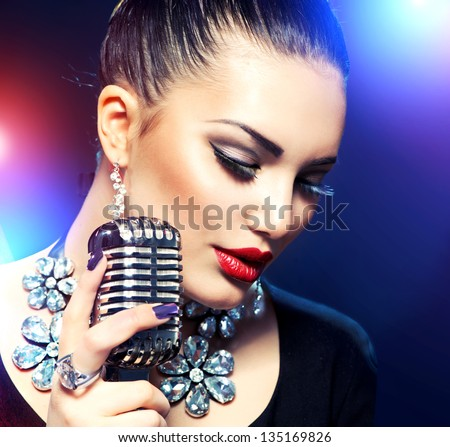 Singing Woman with Retro Microphone. Beauty Glamour Singer Girl. Vintage Style. Song. Karaoke - stock photo
