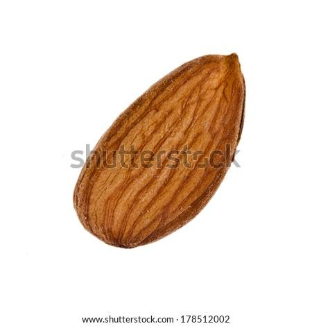 Single Almond Seed Close up Extreme Macro Shot isolated on a white background  - stock photo