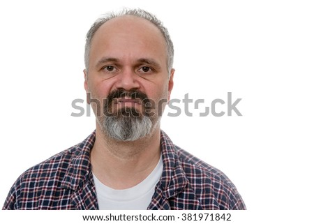 Single balding grumpy old man in beard, mustache and plaid pyjamas with angry expression over white undershirt - stock photo