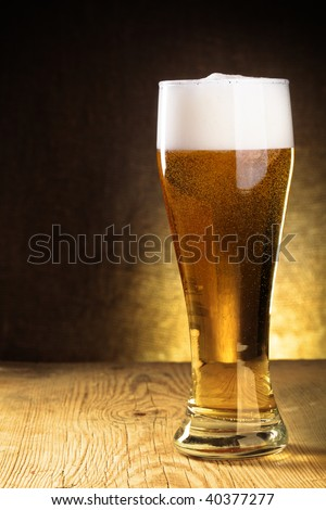 Single  beer glass close-up on wooden table