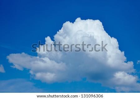 Single big white cloud in a blue sky - stock photo