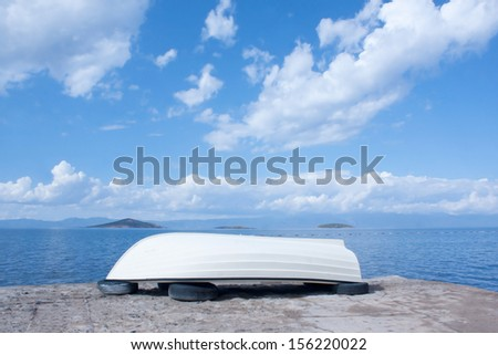 Single boat at sea side  - stock photo