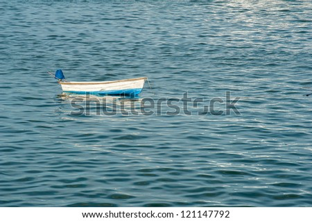 Single boat floating on a andaman sea surface - stock photo