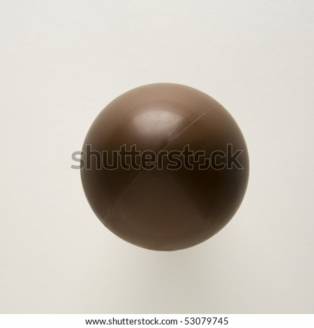 single chocolate easter egg on white background - stock photo