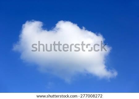 Single cloud in blue sky - stock photo