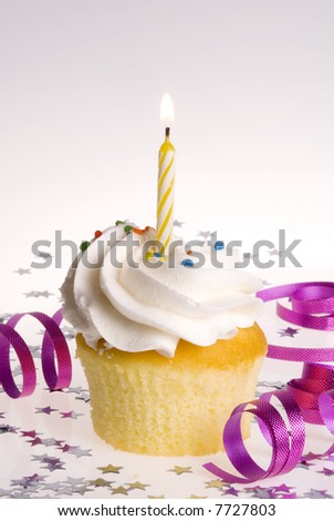 Single cupcake with Yellow Candle - stock photo