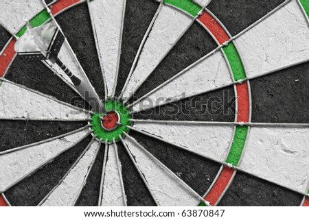 Single dart in the bulls eye on a dart board