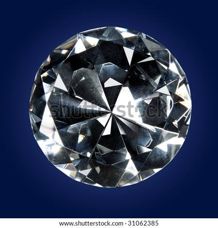 Single diamond over a dark background