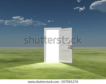 Single door emits light in empty landscape - stock photo