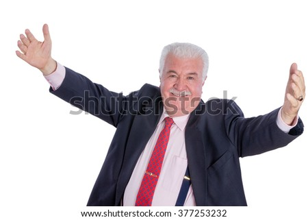 Single elated mature male in blue suit, necktie and suspenders with wide open arms over white background - stock photo
