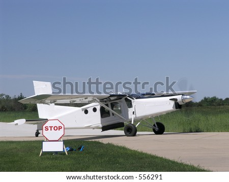 Single engine turboprop taxies to the runway for takeoff - stock photo