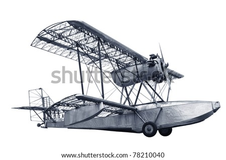 Single engine vintage airplane with some of its coverings stripped off showing skeletal frameworks isolated in white background. - stock photo