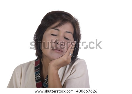 Single exhausted mature woman with tired expression, eyes closed and chin in palm over white background
