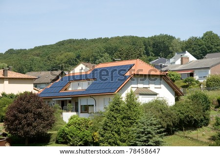 Single-family dwelling with solar on the roof n Germany - stock photo