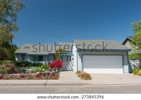Single family house with one level and a short driveway. - stock photo
