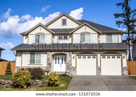 Single family house with two levels and blue sky on background - stock photo
