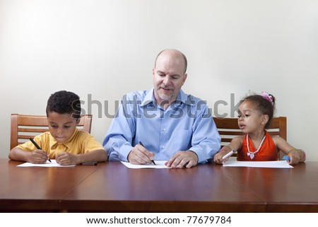 Single father helping kids with homework - stock photo