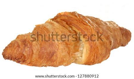 Single fresh baked butter croissant isolated on a white background - stock photo